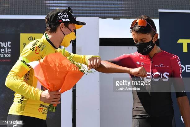 Podium / Primoz Roglic of Slovenia and Team Jumbo - Visma Yellow Leader Jersey / Egan Arley Bernal Gomez of Colombia and Team INEOS / Social...