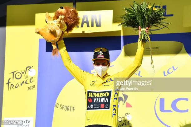 Podium / Primoz Roglic of Slovenia and Team Jumbo - Visma Yellow Leader Jersey / Celebration / Lion Mascot / Trophy / during the 107th Tour de France...
