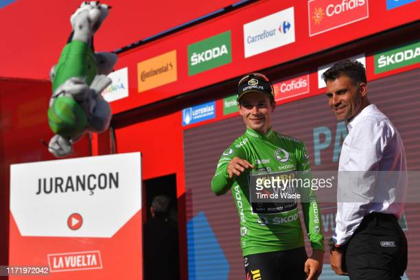 Podium / Primoz Roglic of Slovenia and Team Jumbo-Visma Green Points Jersey / Óscar Pereiro of Spain Ex Pro-cyclist winner of the Tour of France 2006...