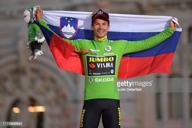 Podium / Primoz Roglic of Slovenia and Team Jumbo-Visma Green Points Jersey / Celebration / Mascot / Slovenian Flag / during the 74th Tour of Spain...