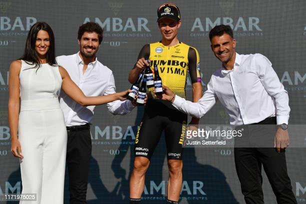 Podium / Primoz Roglic of Slovenia and Team Jumbo-Visma / Óscar Pereiro of Spain Ex Pro-cyclist winner of the Tour of France 2006 / Celebration /...