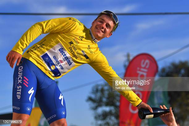Podium / Remco Evenepoel of Belgium and Team Deceuninck - Quick Step Yellow Leader Jersey / Celebration / Champagne / during the 46th Volta ao...