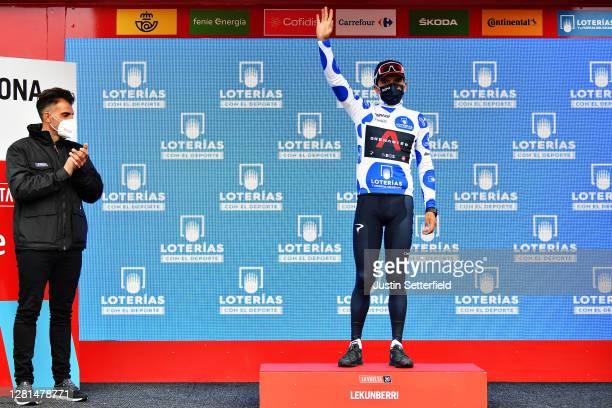 Podium / Richard Carapaz of Ecuador and Team INEOS - Grenadiers Polka Dot Mountain Jersey / Oscar Pereiro of Spain Ex Pro-cyclist winner of the Tour...