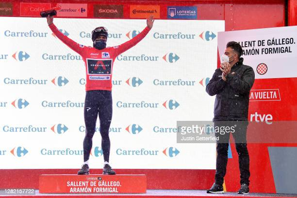 Podium / Richard Carapaz of Ecuador and Team INEOS - Grenadiers Red Leader Jersey / Oscar Pereiro of Spain Ex Pro-cyclist winner of the Tour of...