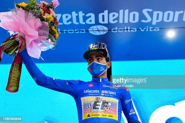 Podium / Ruben Guerreiro of Portugal and Team EF Pro Cycling Blue Mountain Jersey / Celebration / Flowers / Mask / Covid safety measures / during the...