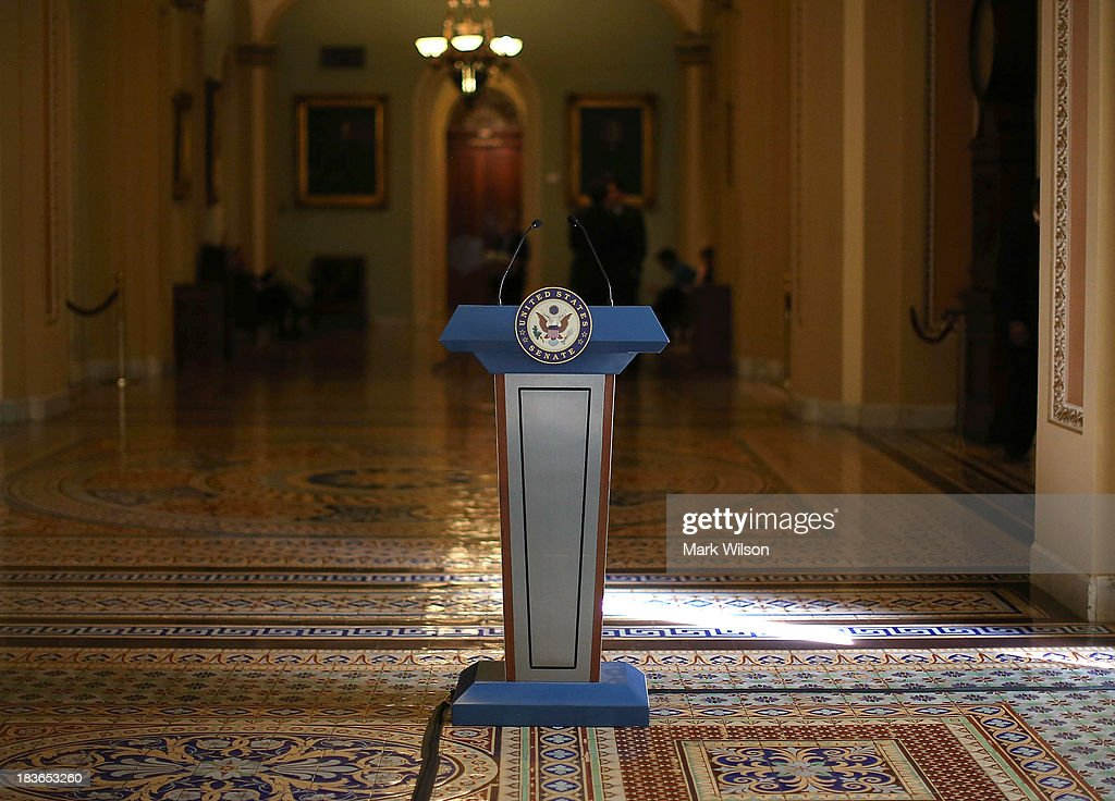 A podium stands where Senate Democrats and Republicans where scheduled to talk to the media after their policy luncheon meetings at the U.S. Capitol, October 8, 2013 in Washington, DC. Democrats and Republicans are still at a stalemate on funding for the federal government as the shutdown goes into eighth day.