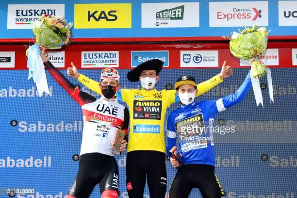 Podium / Tadej Pogacar of Slovenia and UAE Team Emirates, Primoz Roglic of Slovenia and Team Jumbo - Visma Yellow Leader Jersey & Jonas Vingegaard...