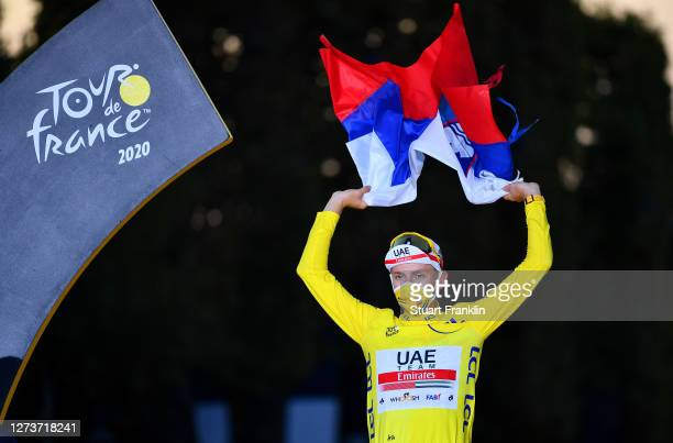 Podium / Tadej Pogacar of Slovenia and UAE Team Emirates Yellow Leader Jersey / Celebration / Trophy / Lion Mascot / Slovenian Flag / during the...