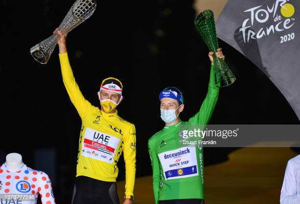 Podium / Tadej Pogacar of Slovenia and UAE Team Emirates Yellow Leader Jersey, White Best Young Rider Jersey and Polka Dot Mountain Jersey / Sam...