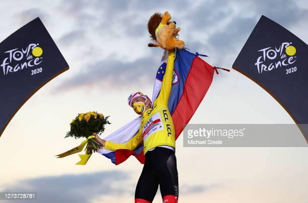 Podium / Tadej Pogacar of Slovenia and UAE Team Emirates Yellow Leader Jersey / Celebration / Mascot / Flowers / Mask / Covid safety measures /...