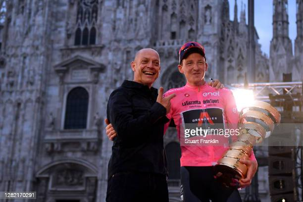 Podium / Tao Geoghegan Hart of The United Kingdom and Team INEOS Grenadiers Pink Leader Jersey / Sir Dave Brailsford of The United Kingdom Senior...