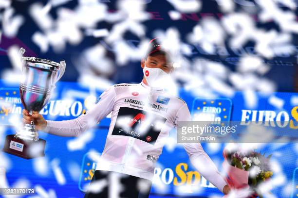 Podium / Tao Geoghegan Hart of The United Kingdom and Team INEOS Grenadiers White Best Young Rider Jersey / Celebration / Champagne / during the...