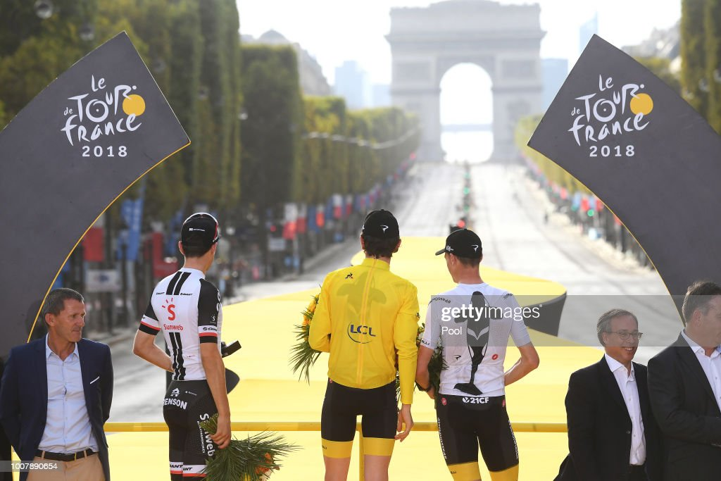 Podium / Tom Dumoulin of The Netherlands and Team Sunweb / Geraint Thomas of Great Britain and Team Sky Yellow Leader Jersey /Celebration / Christopher Froome of Great Britain and Team Sky / Arc De Triomphe / Trophy / during the 105th Tour de France 2018, Stage 21 a 116km stage from Houilles to Paris Champs-Elysees / TDF / on July 29, 2018 in Paris, France.