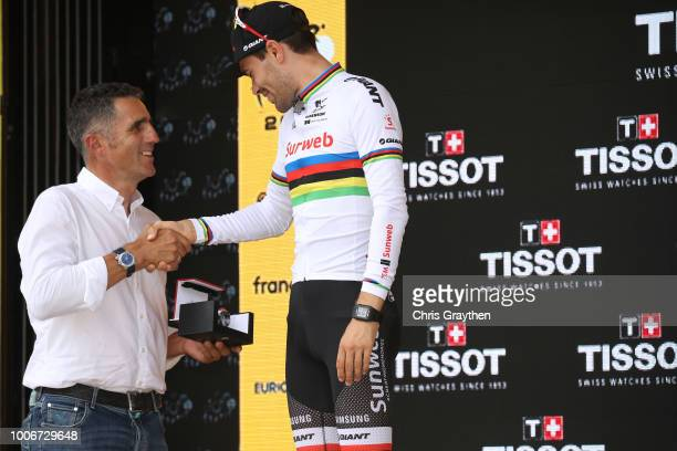 Podium / Tom Dumoulin of The Netherlands and Team Sunweb / Miguel Indurain of Spain Ex Pro-cyclist / Celebration / during the 105th Tour de France...