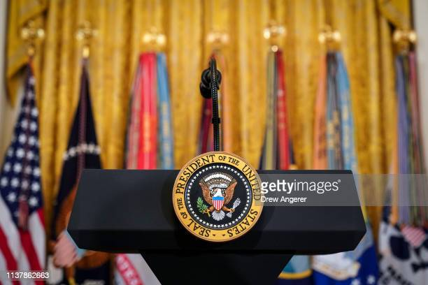 A podium with the presidential seal stands before the start of an event recognizing the Wounded Warrior Project Soldier Ride in the East Room of the...
