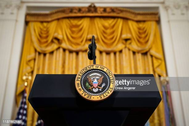 Podium with the presidential seal stands before the start of an event recognizing the Wounded Warrior Project Soldier Ride in the East Room of the...