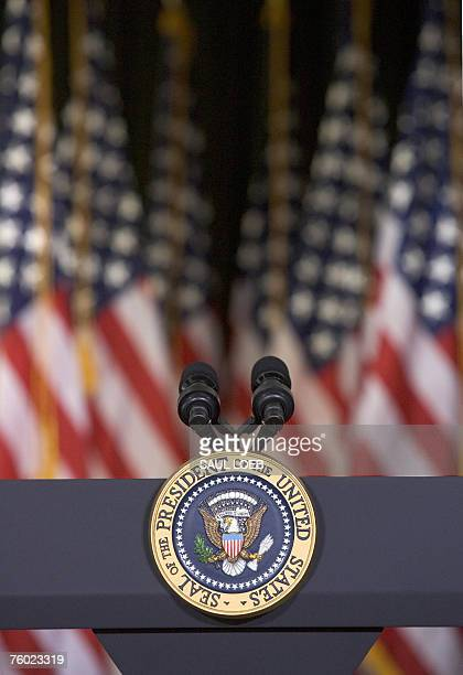 A podium with the seal of the President of the United States and backed by US flags awaits a speech by US President George W Bush on the state of the...