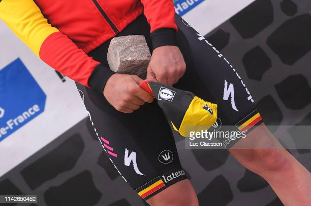 Podium / Yves Lampaert of Belgium and Team Deceuninck-QuickStep / Celebration / Trophy / Cobblestone / Detail view / during the 117th Paris-Roubaix a...