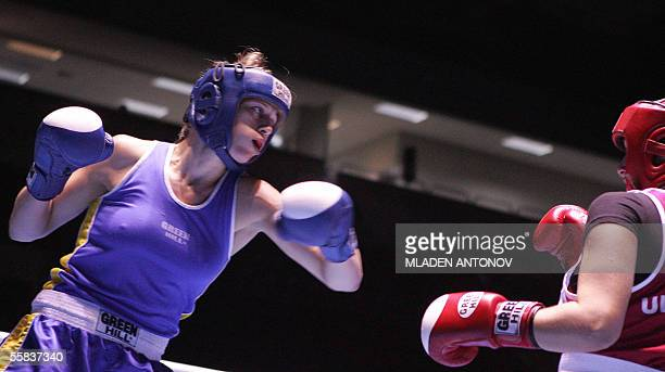 Anna Laurell of S1weden attacks Olga Novikova of Ukraine during their final boxing match in the 75kg category of the World women's boxing...