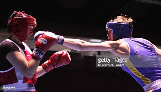 Anna Laurell of Sweden punches Olga Novikova of Ukraine during their final boxing match in the 75kg category of the World women boxing championships...