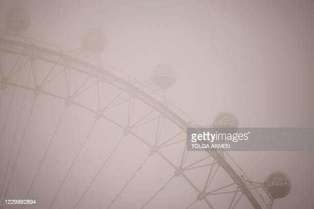 Pods on the London Eye are pictured in the fog in central London on December 7, 2020. - Britain and the European Union will reconvene post-Brexit...