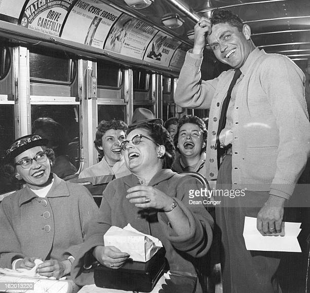 DEC 1 1957 Poem Livens Last Run On '520 Special' Bus driver Marc Kinney and his passengers join in laughter after reading poem about him written for...