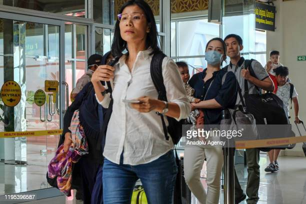 Poeple are seen using a face mask to prevent Coronavirus at Sultan Syarif Kasim II airport in Pekanbaru Riau Province Indonesia on January 23 2020...