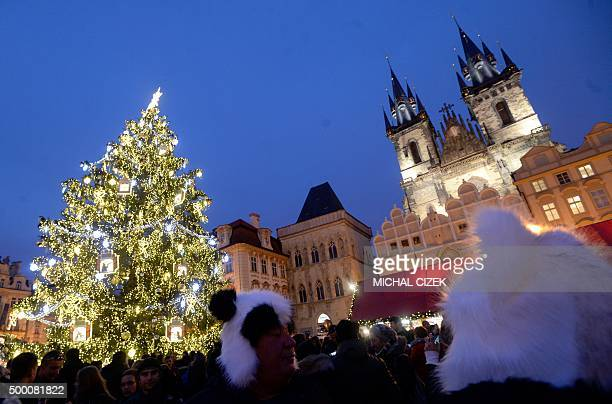 Poeple visit a Christmas market with an illuminated Christmas at the Old Town Square in Prague on December 5 2015 AFP PHOTO / MICHAL CIZEK / AFP /...