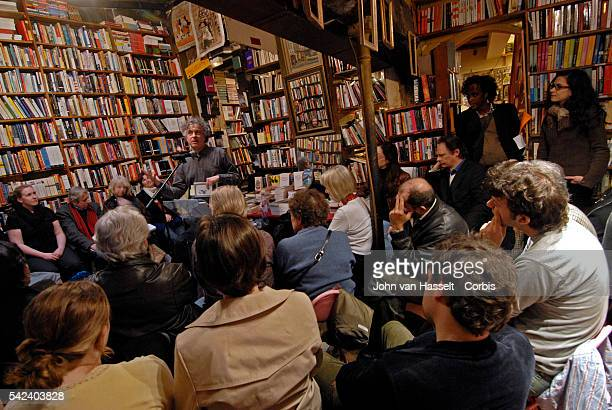 Poet Alan Jenkins reads one of his poems during the Monday evening poetry reading workshop at the bookshop The Shakespeare and Company bookstore...