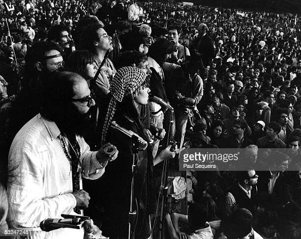 Poet Allen Ginsberg and entourage chanting Om or Aum amid a large crowd during the Human BeIn held at Golden Gate Park San Francisco California...