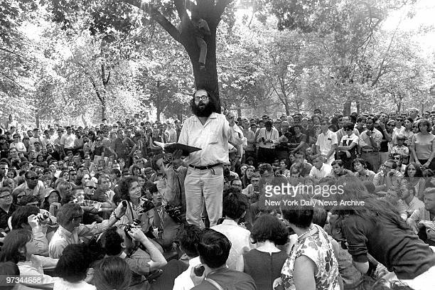 Poet Allen Ginsberg reading his work to a crowd in Washington Square Park
