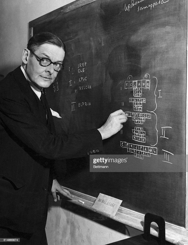 T. S. Eliot Explaining Play on Chalkboard : News Photo