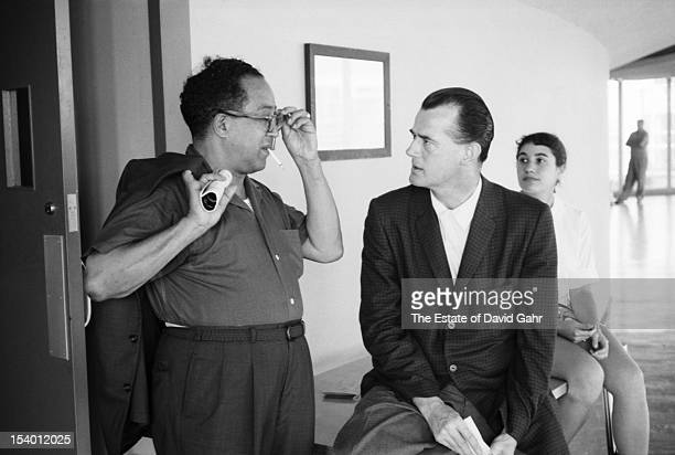 Poet and playwright Langston Hughes converses with folk singer and songwriter Ed McCurdy backstage at the Newport Folk Festival in July, 1959 in...