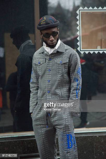 Poet and rapper Kojey Radical wears a Blood Brother jacket and trousers 3 of London Mens Fashion Week Autumn/Winter 2018 on January 08 2018 in London...