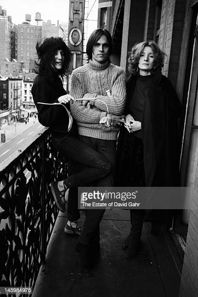 Poet and singer Patti Smith singer songwriter Eric Anderson and actress and Andy Warhol 'superstar' Viva pose for a portrait on May 4 1971 on a...