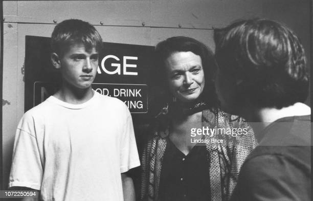 Poet Anne Waldman and her son Ambrose Bye talk with artist George Condo backstage at the Allen Ginsberg Memorial at the Wadsworth Theatre on June 21...