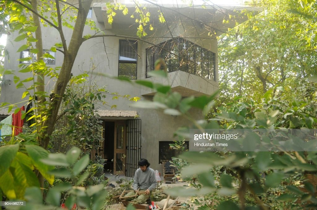 Poet, artist and calligrapher Nilanjan Bandyopadhyay has built a Japanese house-cum-studio to commemorate the centenary of Poet Rabindranath Tagore's first visit to Japan, at Purbapally in Santiniketan, Birbhum dist, on January 8, 2018 in Kolkata, India. A six-member team from Japan is helping poet-curator Nilanjan Bandyopadhyay to build a traditional Japanese house-cum-studio as part of a cross-cultural creative experiment. Poet-curator Nilanjan Bandyopadhyay has embarked on the cross-cultural creative experiment in 2016, the centenary year of the Nobel laureates' first Japan visit. Poet Rabindranath Tagore was so impressed with Japanese arts, architecture and gardens that he had once written, had it been possible he would take an entire Japanese house, decked up with its furniture, to Bengal.