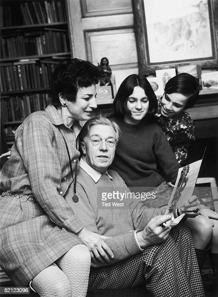 Poet Cecil Day Lewis with his wife Jill son Daniel and daughter Tamasin while reading one of the many letters congratulating him on his appointment...