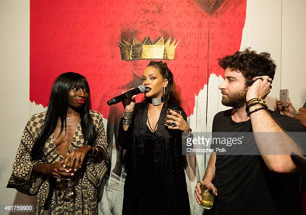 Poet Chloe Mitchell singer Rihanna and artist Roy Nachum at Rihanna's 8th album artwork reveal for 'ANTI' at MAMA Gallery on October 7 2015 in Los...