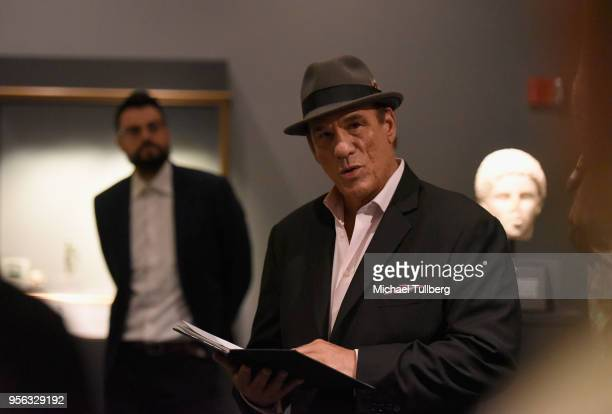 Poet Gabriele Tinti watches as actor Robert Davi recites Tinti's poetry at BritWeek at The Getty Villa on May 8 2018 in Pacific Palisades California