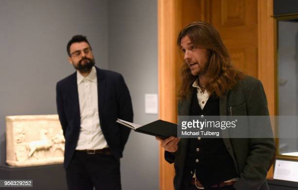 Poet Gabriele Tinti watches as filmmaker Oscar Sharp recites Tinti's poetry at BritWeek at The Getty Villa on May 8 2018 in Pacific Palisades...