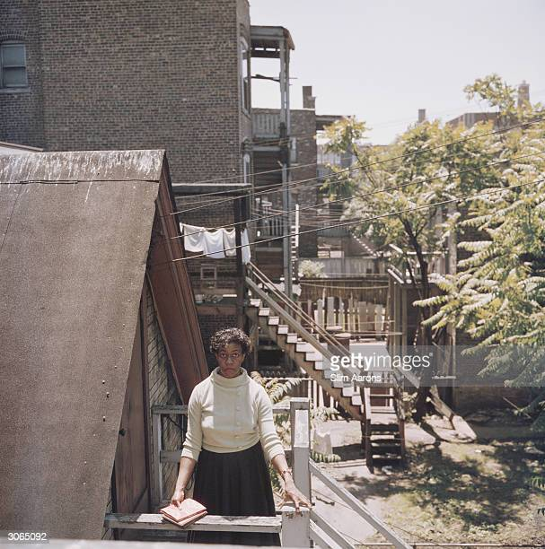Poet Gwendolyn Brooks on the back steps of her home in Chicago