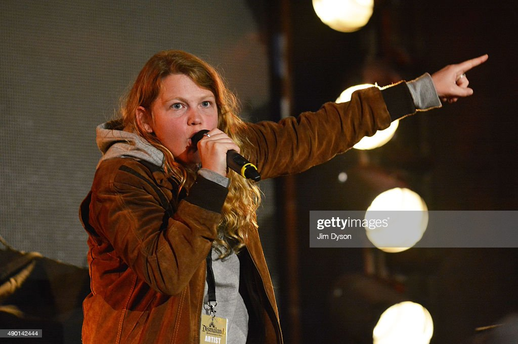 Poet Kate Tempest performs live on stage during the final weekend closing party of Dismaland on September 25, 2015 in Weston-Super-Mare, England. Graffiti artist Banksy opened the subversive, pop-up 'Bemusement Park' exhibition at the derelict seafront Tropicana lido for five weeks, attracting 150,000 visitors.
