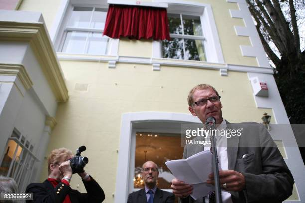 Poet Laureate Andrew Motion right speaks during an unveiling ceremony for a blue plaque commemorating the poet writer and broadcaster Sir John...