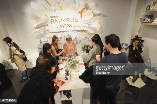Poet Lisa Ann Markuson writes haikus during the Haiku Girls event in the Papyrus Café during IMG NYFW The Shows at Spring Studios on February 11 2018...