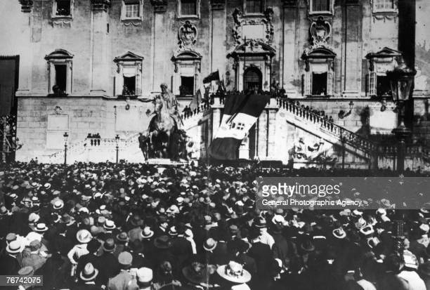 Poet playwright and Italian nationalist Gabriele d'Annunzio addresses a crowd from the Palazzo Senatorio in the Piazza del Campidoglio in Rome circa...
