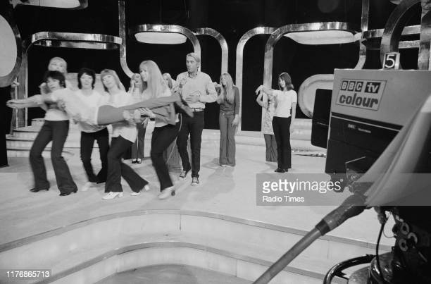 Poet Rod McKuen surrounded by dancers as he performs on set for the BBC television show 'A Royal Television Gala Performance' London May 12th 1970