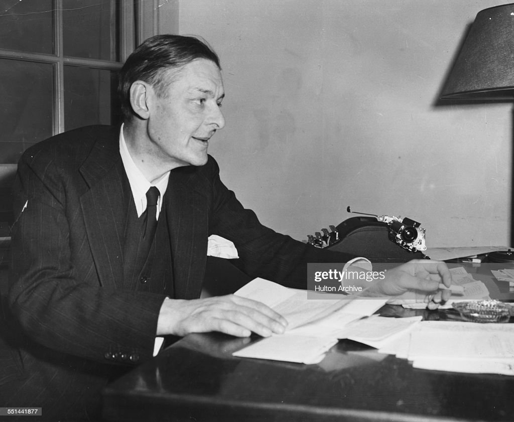 Poet T. S. Eliot, recently awarded the Nobel Prize in Literature, working at his desk in the Institute for Advanced Study at Princeton, New Jersey, circa 1948.