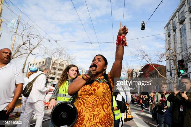 Poet Terisa Siagatonu leads a chant during the San Francisco Women's March on January 19 2019 in San Francisco California