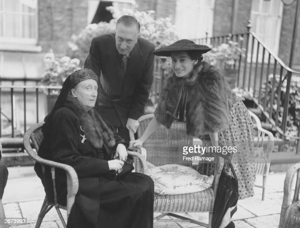 Poetess Edith Sitwell chatting with composer Sir William Walton and his wife Lady Walton during a Royal Society of Literature Garden Party held at...